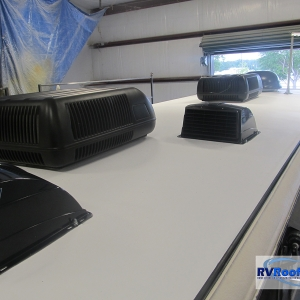 Class-a-with-finished-sprayed-RV-roof-FlexArmor-and-black-vent-covers